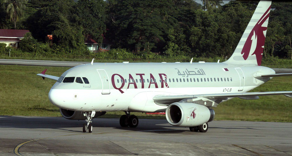 A Qatar Airways plane sits on the tarmac at Yangon International Airport in Yangon, Myanmar, Thursday, Oct. 4, 2012. Qatar Airways will resume flying to Myanmar's biggest city in the latest indicator of international interest in the Southeast Asian nation as it boosts its welcome to investors and tourism. The airline said in a statement Wednesday that it will relaunch its Doha-Yangon route that had been suspended in January 2008. It said the thrice-weekly flights will resume this Friday. (AP Photo/Khin Maung Win)/MYN101/248037477813/1210041007